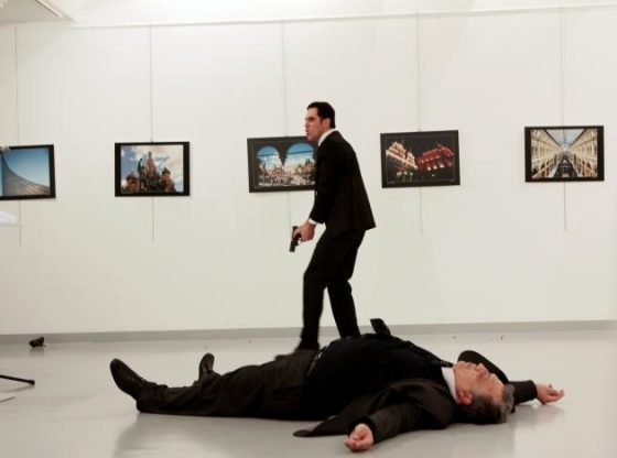 Andrei Karlov being gunned down by the man behind him.