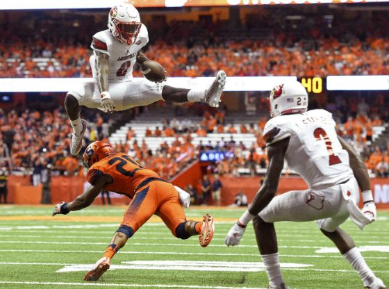 Lamar Jackson Leaps over defender